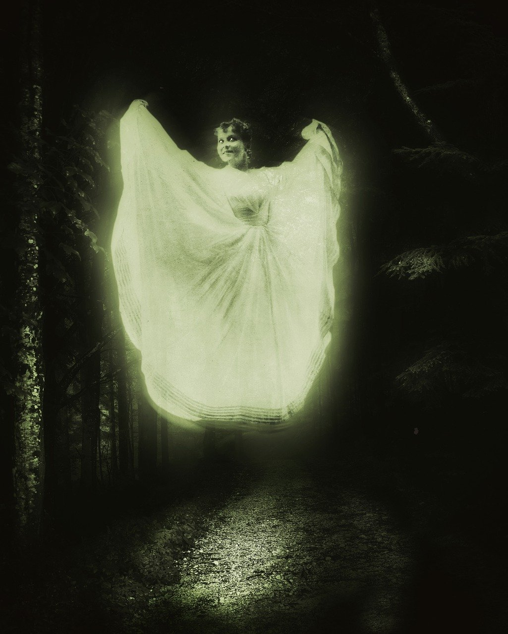 image of a young woman in a white gown floating over a dirt road in a forest
