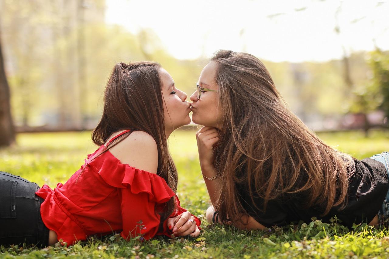 Three Asian Girls Kissing