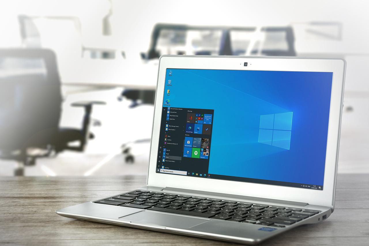 A laptop opens to a Windows screen