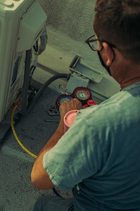 A technician repairing an AC