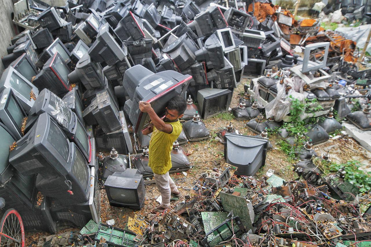 A pile of TVs and monitors piles up creating a huge pile of e-waste.