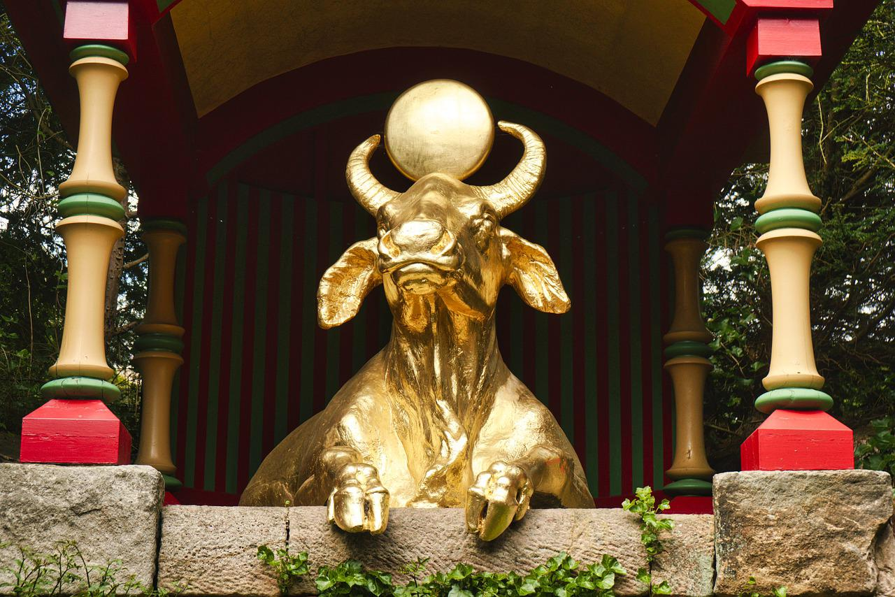 A golden bull statue.
