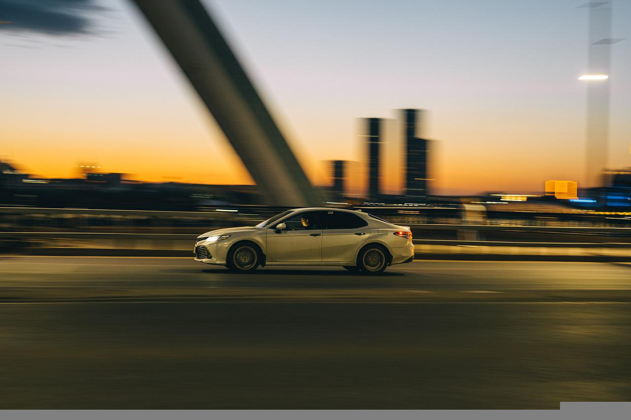Camry driving at sunset